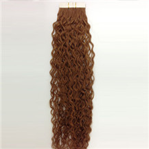https://image.markethairextensions.ca/hair_images/Tape_In_Hair_Extension_Curly_30_Product.jpg